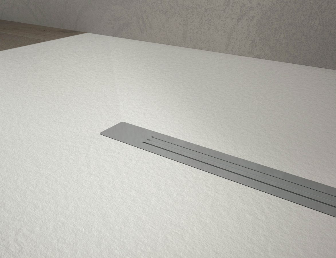 piatto-krus-dettaglio-piletta-acciaio-piatti-doccia-disenia
